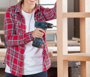A woman using power tools