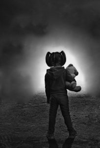 a girl with her teddy bear feeling alone and afraid, facing childhood abuse